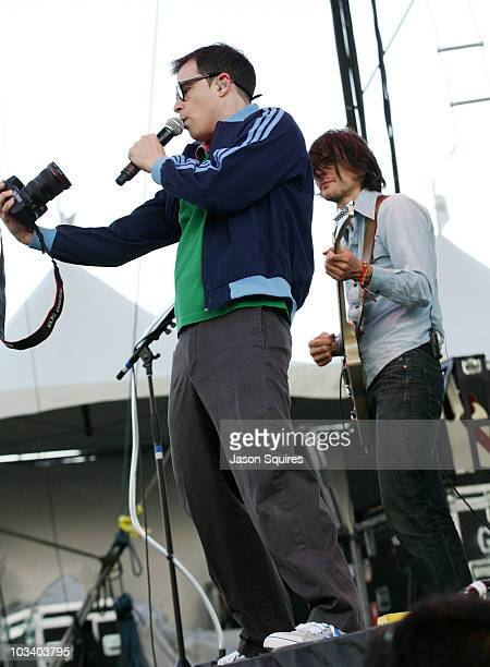 Singer/musician Rivers Cuomo of the band Weezer grabs a photographer's camera and photographs himself and the crowd at Dick's Sporting Goods Park on...