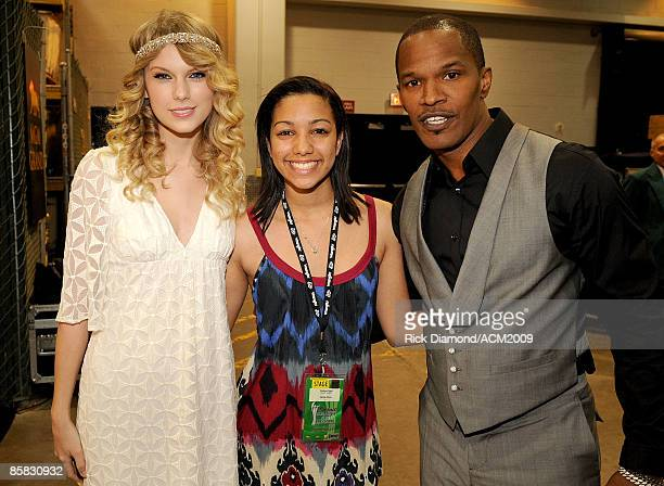 Singer/musician Taylor Swift Corinne Foxx and father actor Jamie Foxx pose backstage during the 44th annual Academy Of Country Music Awards' Artist...