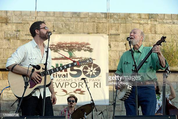 Singer/Musicians Tao Rodriguez Seeger and his grandfather Pete Seeger perform during day 1 of the George Wein Folk Festival 50 at Fort Adams State...