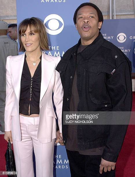 US singerproducer Dr Dre arrives at the 43rd Annual Grammy Awards with his wife Nicole in Los Angeles 21 February 2001 AFP PHOTO/ Lucy NICHOLSON