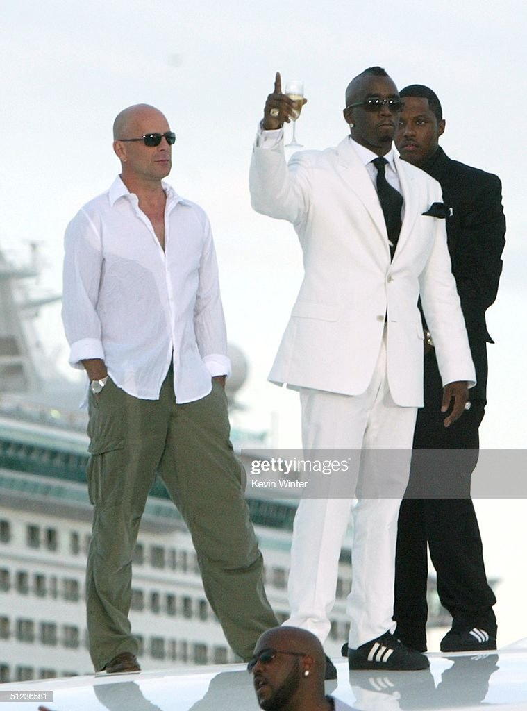 Singerproducer Sean P Diddy Combs And Bruce Willis Arrive By