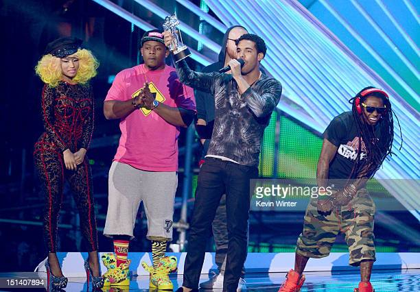 Singer/rapper Nicki Minaj and rappers Drake and Lil Wayne accept the award for Best Hip Hop Video onstage during the 2012 MTV Video Music Awards at...