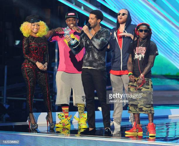 Singer/rapper Nicki Minaj and rappers Drake and Lil Wayne accept the award for Best Hip Hop Video onstage at the 2012 MTV Video Music Awards at...