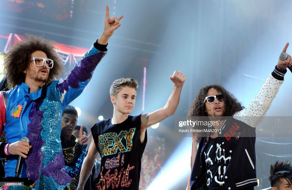 Singer/rapper Redfoo of LMFAO, singer Justin Bieber and singer/rapper SkyBlu of LMFAO perform onstage at the 2011 American Music Awards held at Nokia Theatre L.A. LIVE on November 20, 2011 in Los Angeles, California.