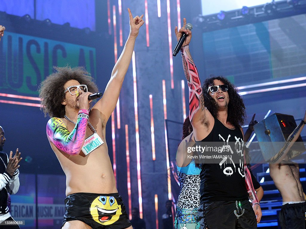 Singer/rappers Redfoo and SkyBlu (R) of LMFAO perform onstage at the 2011 American Music Awards held at Nokia Theatre L.A. LIVE on November 20, 2011 in Los Angeles, California.