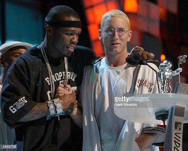 Singers 50 Cent and Eminem speak onstage during the 2003 MTV Video Music Awards at Radio City Music Hall on August 28 2003 in New York City