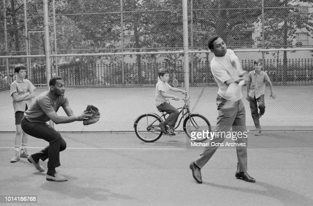 Singers Abdul 'Duke' Fakir and Renaldo 'Obie' Benson of American vocal group the Four Tops take part in a sports event in New York City 1965