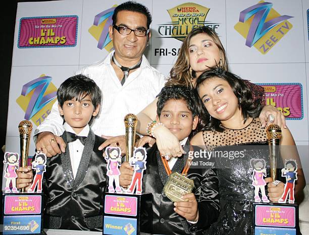 Singers Abhijeet and Alka Yagnik pose with the finalists of the reality show Little ChampsHemant Brijwasi Shreyasi Bhattacharjee and Yatharth Ratnam...