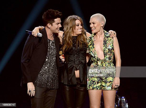 Singers Adam Lambert Angie Miller and Jessie J speak onstage during Fox's American Idol 2013 Finale Results Show at Nokia Theatre LA Live on May 16...