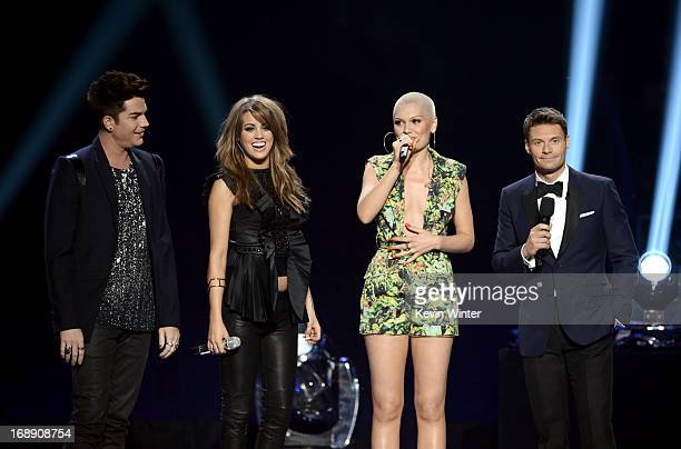 Singers Adam Lambert Angie MillerJessie J and host Ryan Seacrest speak onstage during Fox's American Idol 2013 Finale Results Show at Nokia Theatre...