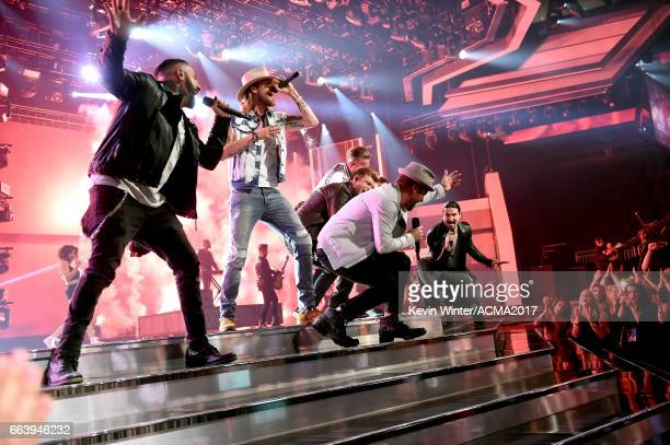 Singers AJ McLean Brian LittrellTyler Hubbard Brian Kelley Nick Carter and Howie Dorough of Backstreet Boys and Florida Georgia Line perform onstage...
