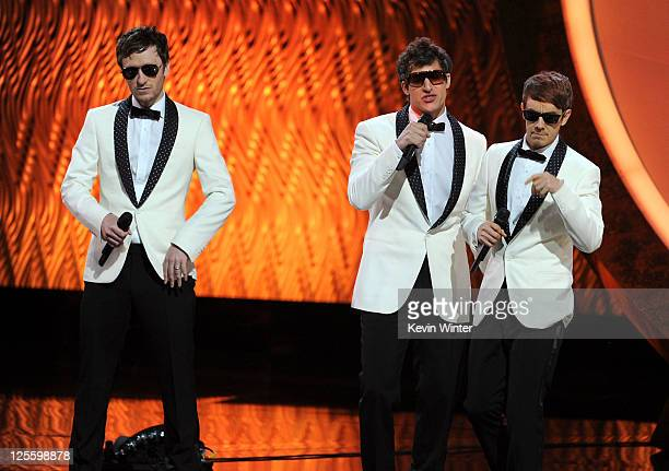 Singers Akiva Schaffer Andy Samberg Jorma Taccone of The Lonely Island perform onstage during the 63rd Annual Primetime Emmy Awards held at Nokia...
