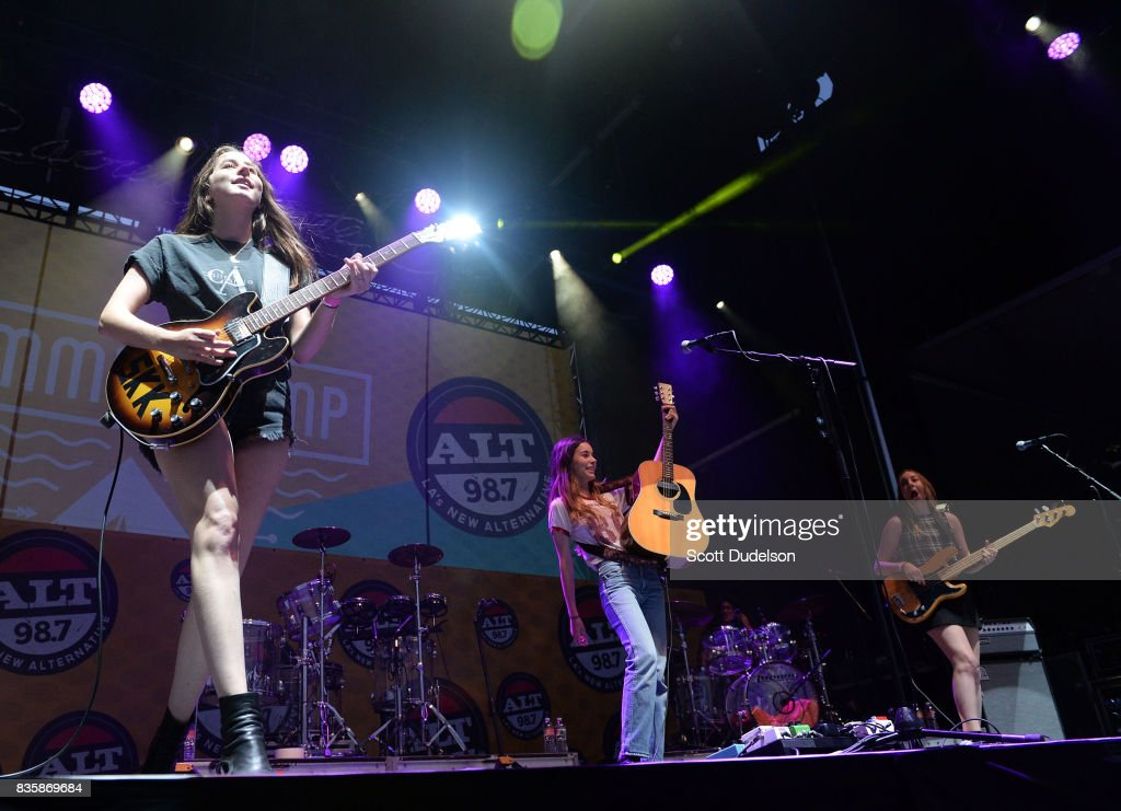 Singers Alana Haim (L), Danielle Haim (C) and Este Haim (R) of the band HAIM perform onstage during the Alt 98.7 Summer Camp concert at Queen Mary Events Park on August 19, 2017 in Long Beach, California.