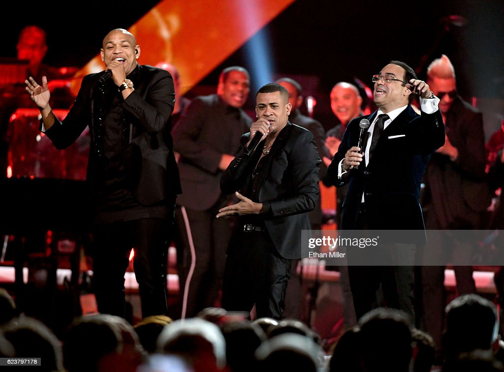 Singers Alexander Delgado and Randy Malcom of Gente de Zona with Gilberto Santa Rosa perform onstage during the 2016 Person of the Year honoring Marc Anthony at MGM Grand Garden Arena on November 16, 2016 in Las Vegas, Nevada.