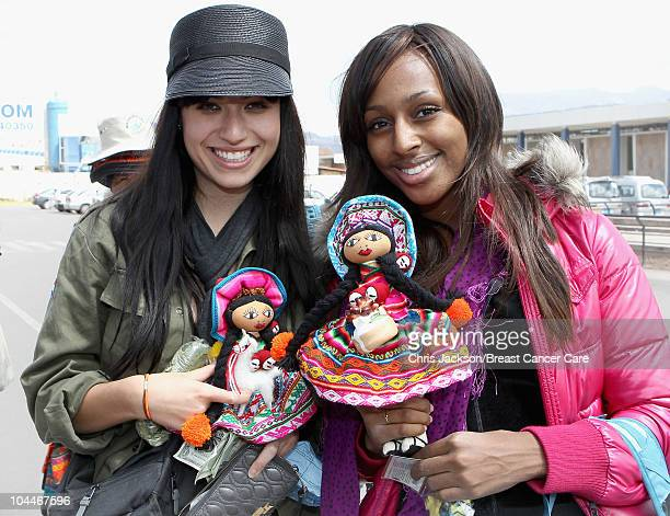 Singers Alexandra Burke and Gabriella Cilmi hold up traditional Peruvian dolls bought as they arrive at Cusco Airport ahead of Denise and Fearne's...