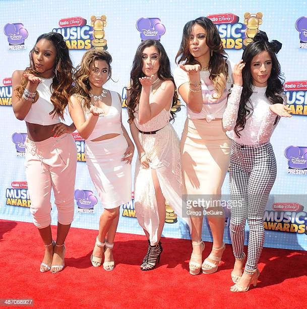 Singers Ally Brooke Hernandez, Normani Hamilton, Dinah Jane Hansen, Camila Cabello and Lauren Jauregui of Fifth Harmony arrive at the 2014 Radio...