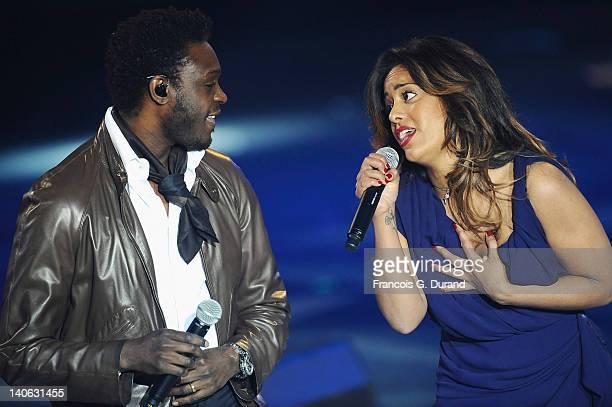 Singers Amel Bent and Corneille perform during 'Les Victoires de La Musique 2012' at Palais des Congres on March 3 2012 in Paris France