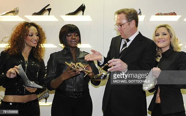 Singers Amelle Berrabah Keisha Buchanan and Heidi Range of the British girl group 'Sugababes' pose with Heinrich Deichmann chairman of the...