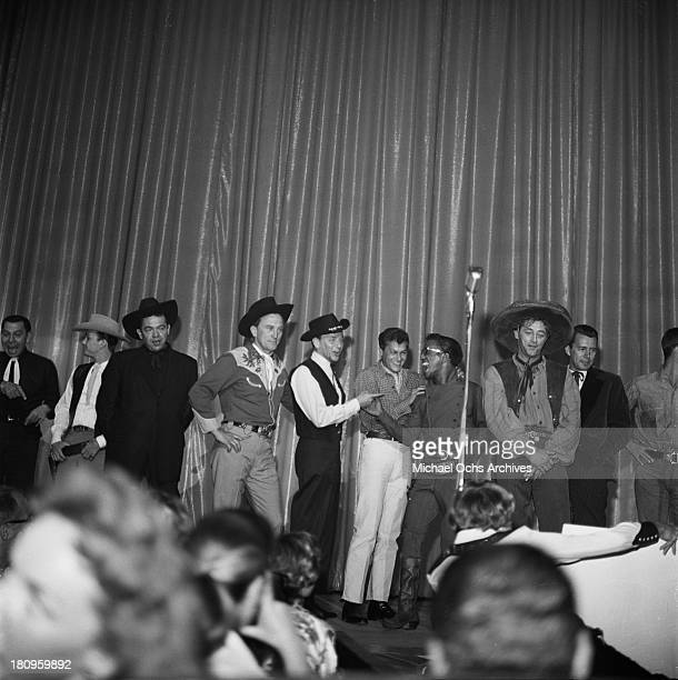 Singers and actors including Louis Prima Kirk Douglas Frank Sinatra Tony Curtis Dammy Davis Jr Robert Mitchum and John Forsythe perform at the SHARE...