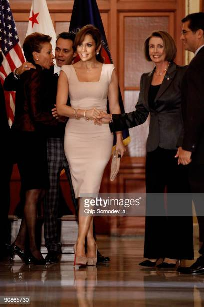Singers and actors Jennifer Lopez and her husband Marc Anthony are welcomed by Congressional Hispanic Caucus Chair Rep Nydia M Velázquez Speaker of...