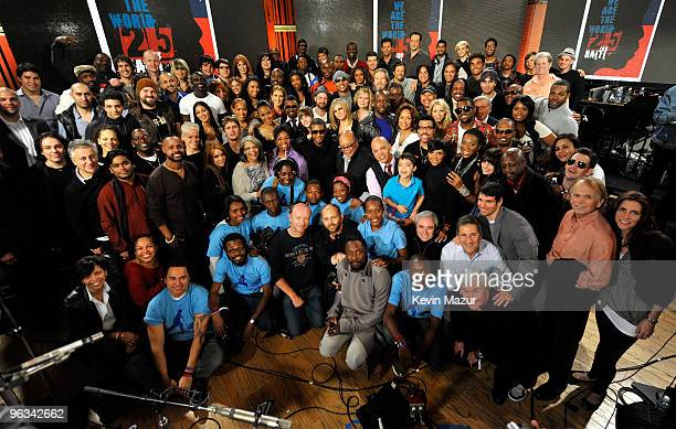COVERAGE* Singers and producers of We Are The World 25 Years for Haiti pose for a group picture following the recording session held at Jim Henson...