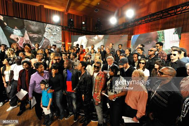 COVERAGE* Singers and producers of 'We Are The World 25 Years for Haiti' pose for a group picture following the recording session held at Jim Henson...