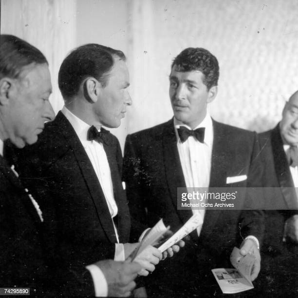 Singers and Rat Pack members Frank Sinatra and Dean Martin attend a Friar's Club dinner on February 14 1957 in Los Angeles California
