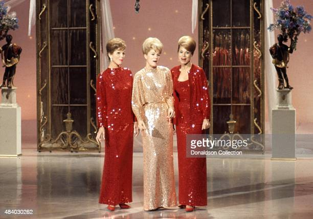 Singers and sisters Phyllis McGuire Christine McGuire and Dororthy McGuire of the vocal group The McGuire Sisters perform on a TV show in March 1966...