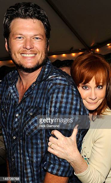 Singers and Songwriters Blake Shelton and Reba Mcentire attend a Barn Party Bonfire Celebration of two's OVER YOU DRINK ON IT hosted by Miranda...
