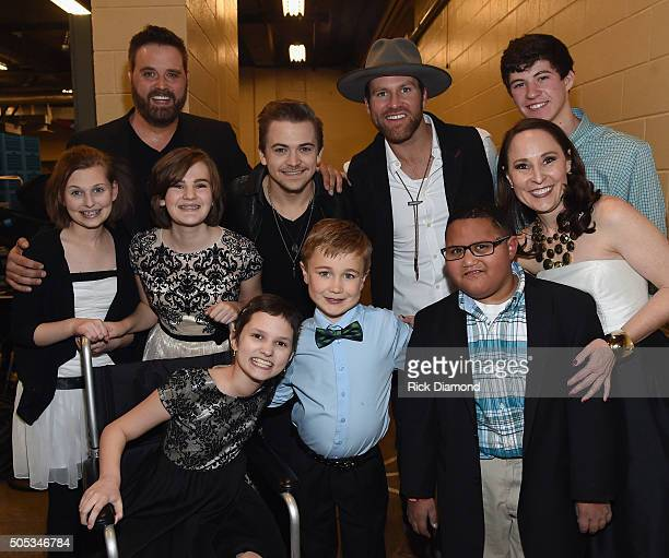 Singers and Songwriters Randy Houser Hunter Hayes and Drake White With Wish Kids Levi Caroline Camryn Lily Josh Micah and Beth Torres President and...
