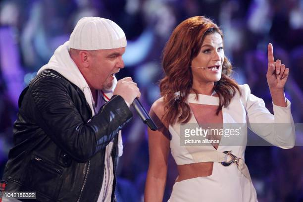 Singers Andrea Berg and DJ Otzi sing on stage during the television show 'Das Glueckwunschfest Silbereisen gratuliert' in Riesa Germany 20 February...