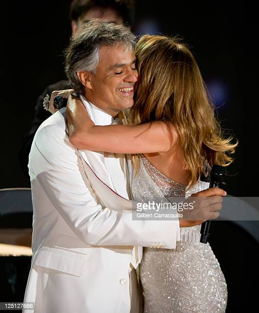 Singers Andrea Bocelli and Celine Dion perform at the Central Park Great Lawn on September 15 2011 in New York City
