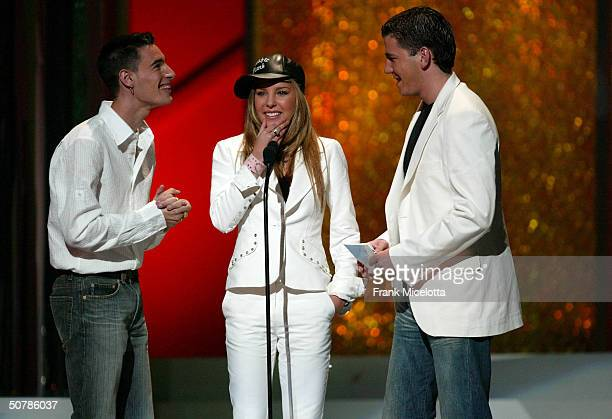 Singers Andy Belinda and Lucas speak onstage during the 2004 Billboard Latin Music Awards at the Miami Arena April 29 2004 in Miami Florida