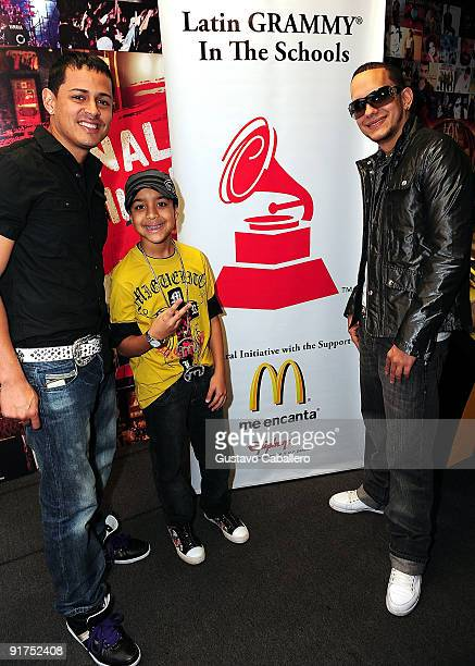 Singers AngelMiguelito and Khriz attends the Latin GRAMMY in the Schools at Miami Coral Park Senior High School on October 9 2009 in Miami Florida