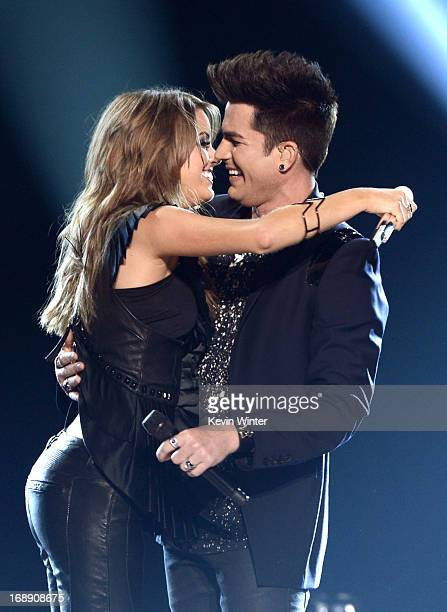 Singers Angie Miller and Adam Lambert perform onstage during Fox's American Idol 2013 Finale Results Show at Nokia Theatre LA Live on May 16 2013 in...