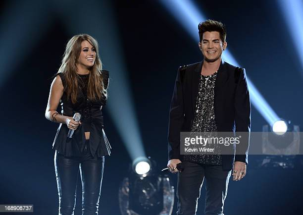 Singers Angie Miller and Adam Lambert speak onstage during Fox's American Idol 2013 Finale Results Show at Nokia Theatre LA Live on May 16 2013 in...