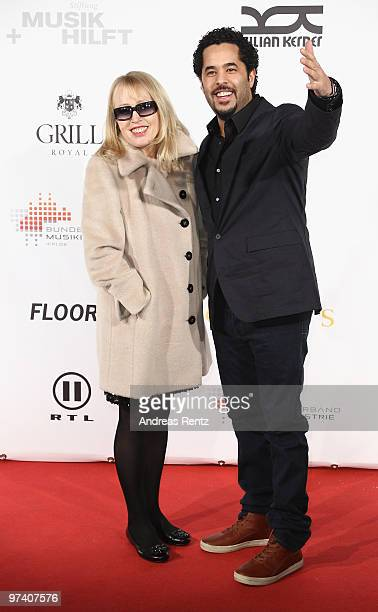 Singers Annette Humpe and Adel Tawil attend the 'Musik Hilft' charity dinner at Grill Royal on March 3 2010 in Berlin Germany