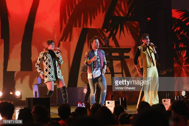Singers Ashley Grace Perez of HaAsh Prince Royce and Hanna Nicole of HaAsh perform on stage with Los Polinesios during the Nickelodeon Kids' Choice...