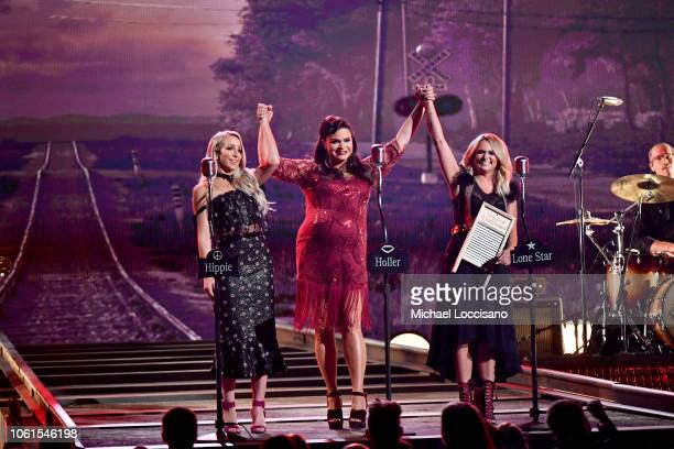 Singers Ashley Monroe Angaleena Presley and Miranda Lambert of Pistol Annies perform onstage during the 52nd annual CMA Awards at the Bridgestone...