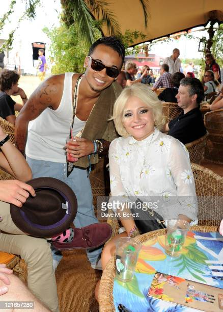 Singers Aston Merrygold and Pixie Lott attend the launch of Mahiki Coconut liqueur backstage during Day Two of V Festival 2011 on August 21 2011 in...