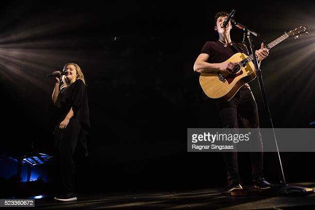 Singers Astrid S and Shawn Mendes perform on stage at Oslo Spektrum on April 22 2016 in Oslo Norway