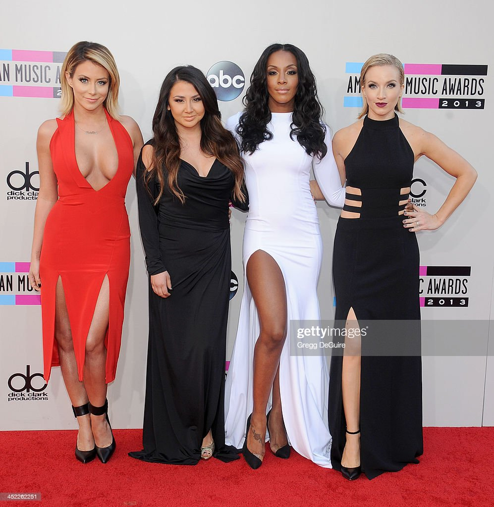 Singers Aubrey O'Day, Aundrea Fimbres, Dawn Richards and Shannon Bex of Danity Kane arrive at the 2013 American Music Awards at Nokia Theatre L.A. Live on November 24, 2013 in Los Angeles, California.