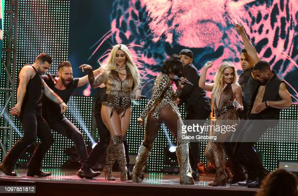 Singers Aubrey O'Day, Dawn Richard and Shannon Bex of Danity Kane perform with backup dancers during the 2019 GayVN Awards show at The Joint inside...