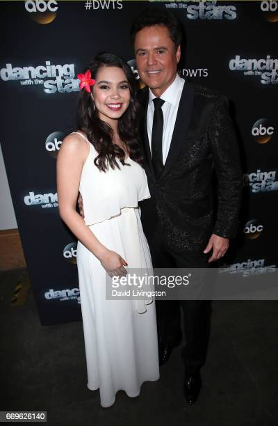 Singers Auli'i Cravalho and Donny Osmond attend 'Dancing with the Stars' Season 24 at CBS Televison City on April 17 2017 in Los Angeles California