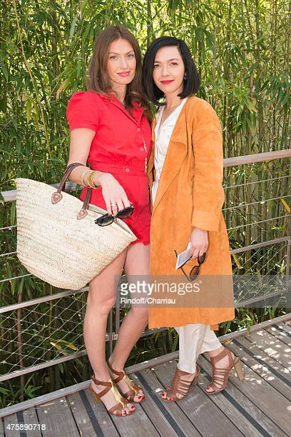 Singers Aurelie Saada and Sylvie Hoarau of Brigitte attend the French Open at Roland Garros on June 4 2015 in Paris France