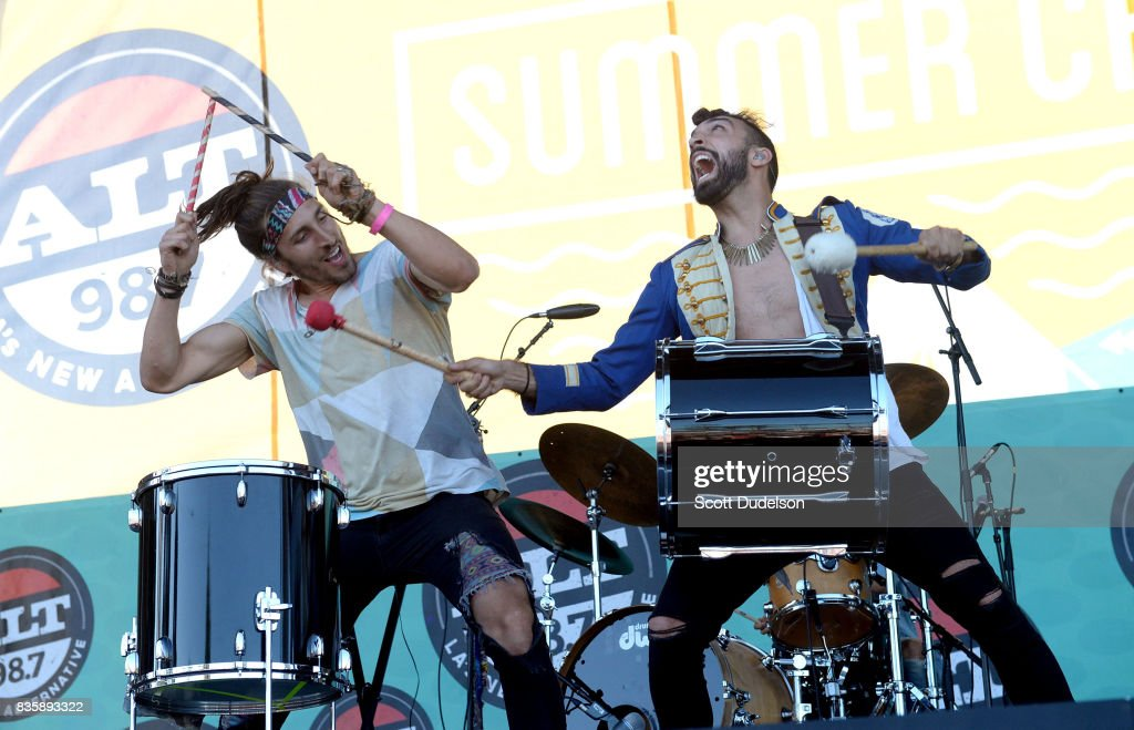 Singers Austin Bisnow (L) and Zambricki Li (R) of Magic Giant perform onstage during the Alt 98.7 Summer Camp concert at Queen Mary Events Park on August 19, 2017 in Long Beach, California.