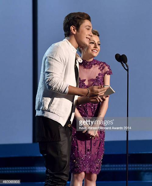 Singers Austin Mahone and Cher Lloyd speak onstage during the 2014 Billboard Music Awards at the MGM Grand Garden Arena on May 18 2014 in Las Vegas...