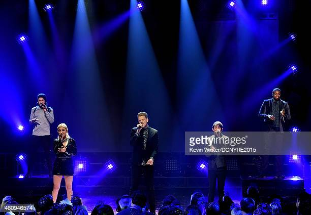 Singers Avi Kaplan Kristie Maldonado Scott Hoying Mitch Grassi and Kevin Olusola of Pentatonix perform at Dick Clark's New Year's Rockin' Eve With...