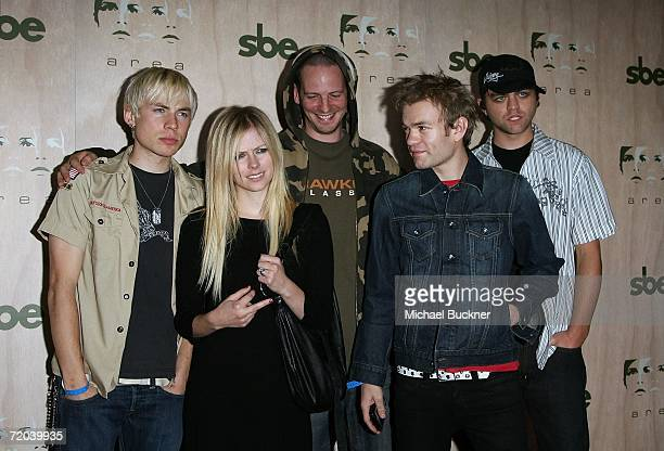 Singers Avril Lavigne and Deryck Whibley arrive at the AREA Nightclub Grand Opening on September 28 2006 in Los Angeles California