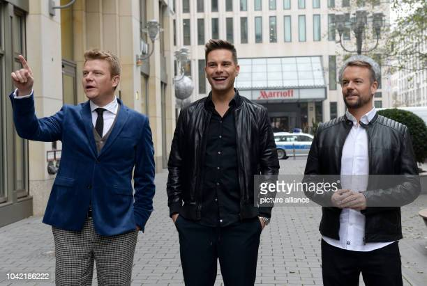 Singers Bastiaan Ragas, Eloy de Jong, and Lee Baxter from the English-Dutch boy band 'Caught in the Act' arrive to the press conference 'New Year's...